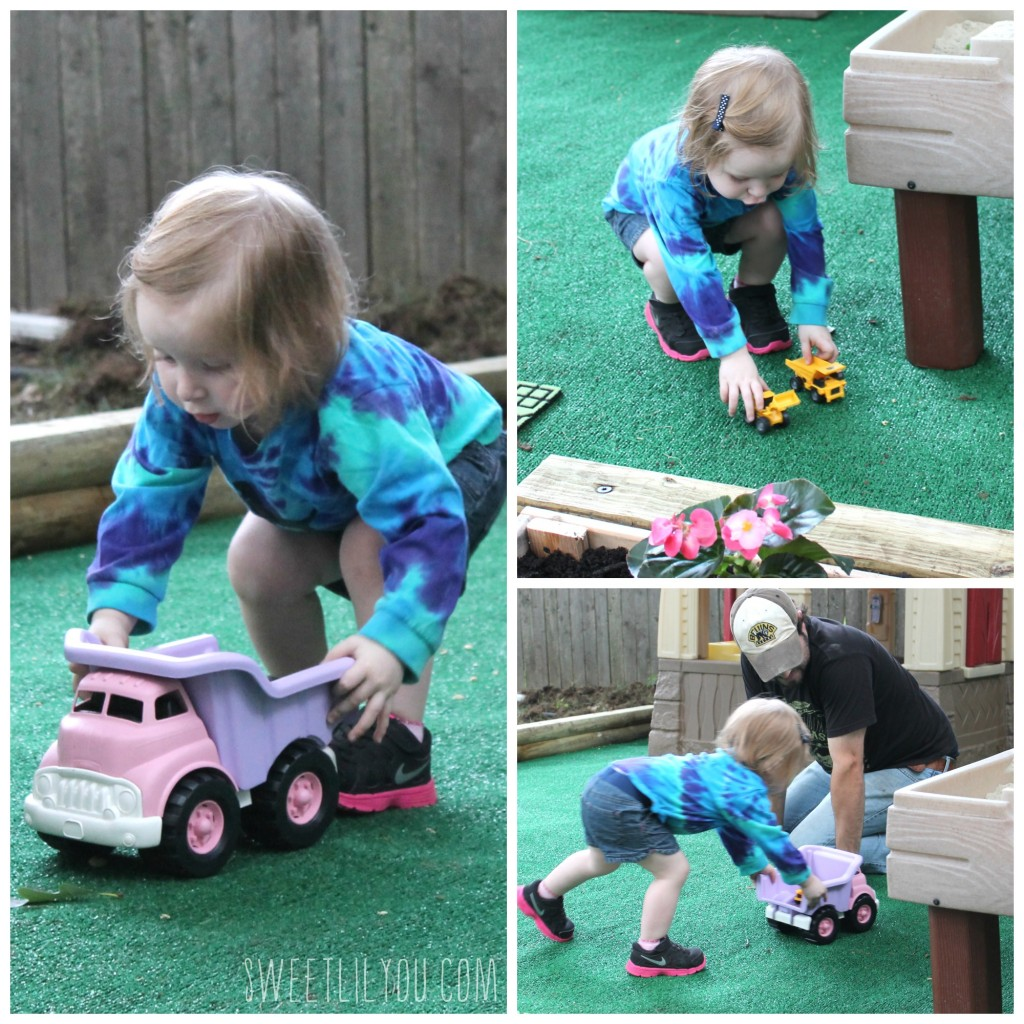 driving her trucks in her new play space!