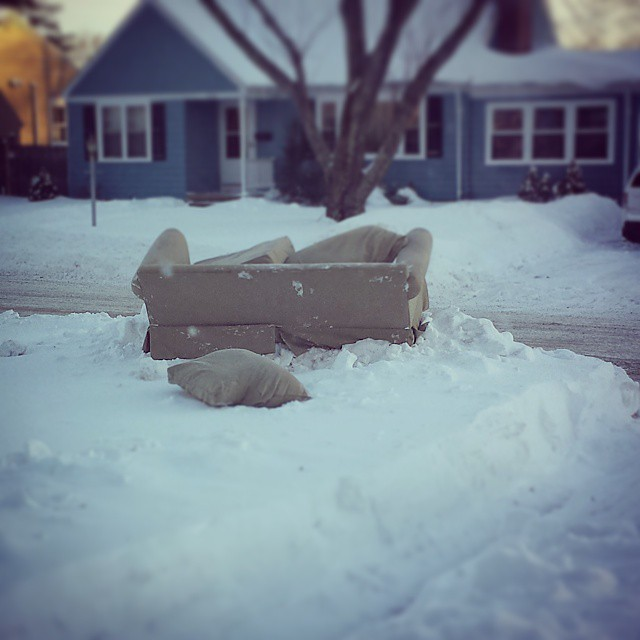 Old couch on the curb. Trash it, don't donate it! Charitable donation