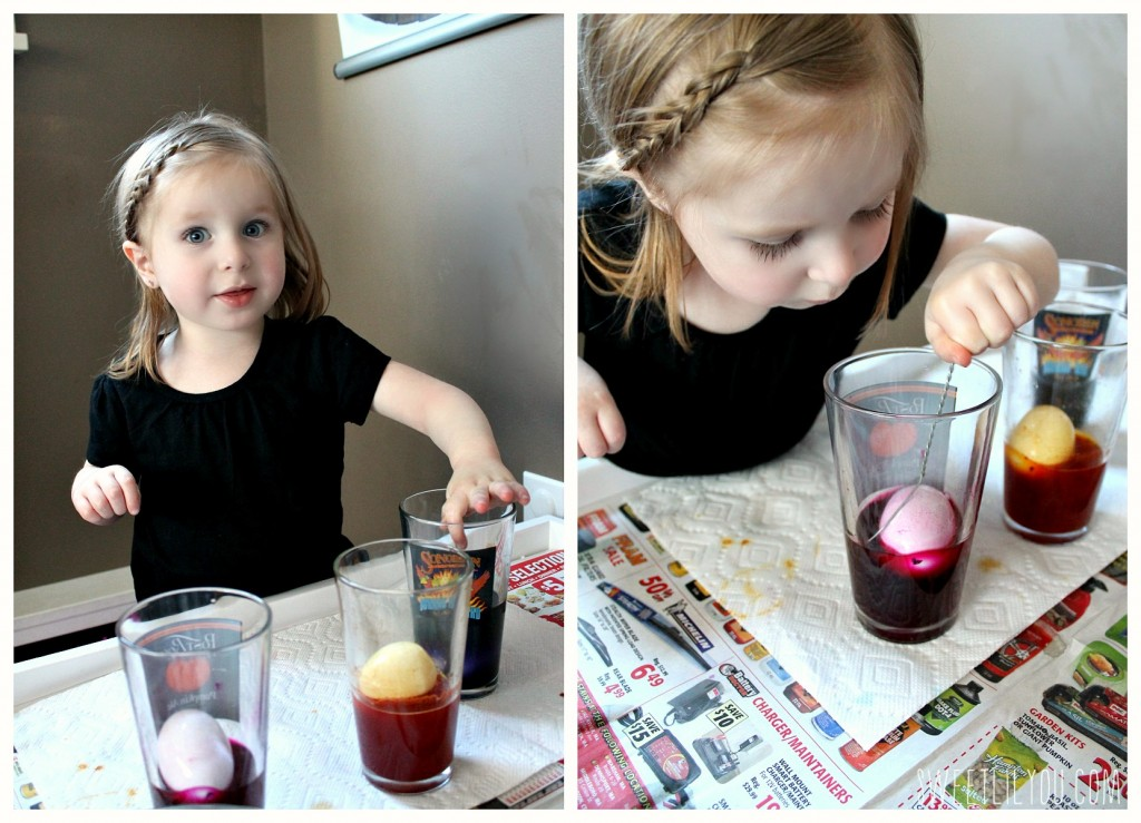 Avery coloring eggs with all natural dye