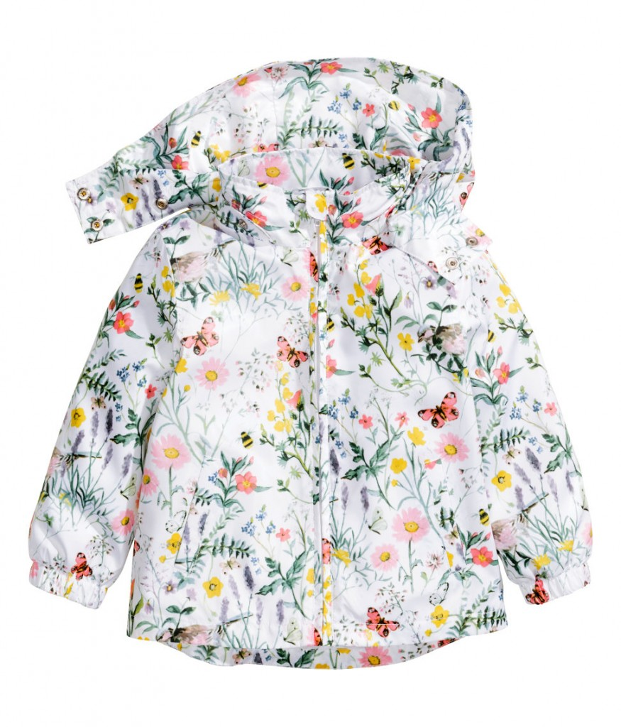 Patterned jacket with detachable lined hood, concealed front zip, side pockets, and elasticized cuffs. Lined.
