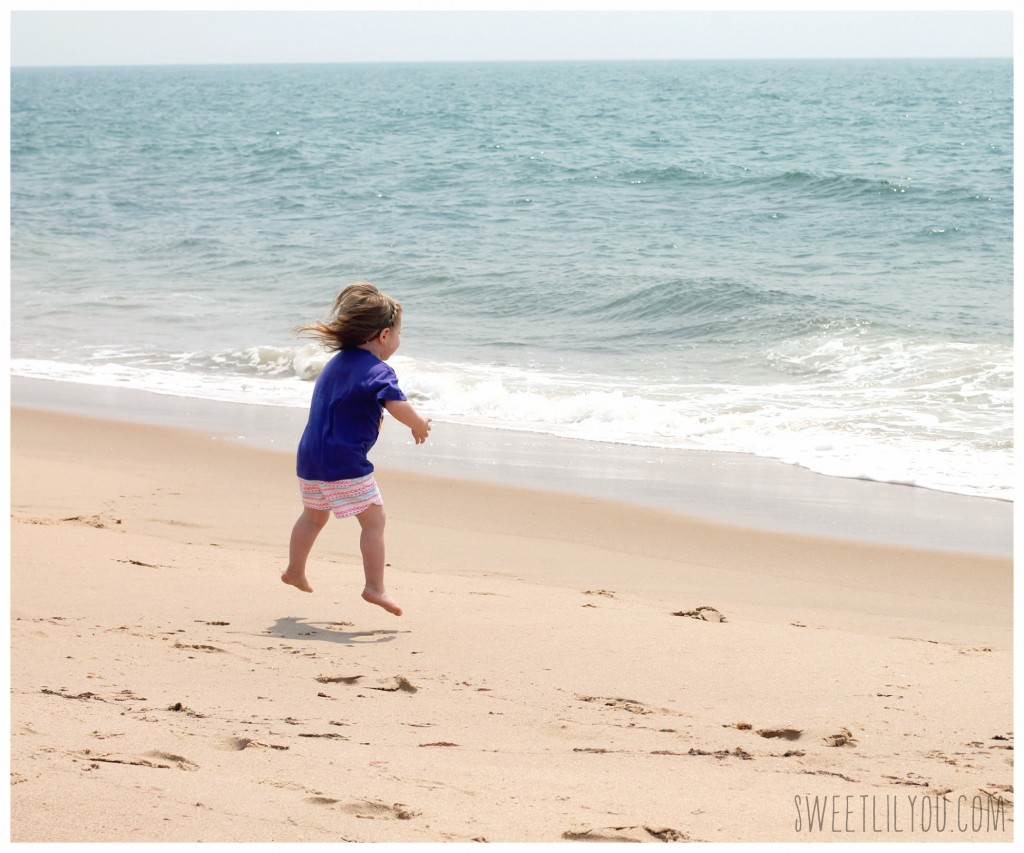 Avery jumping on the beach