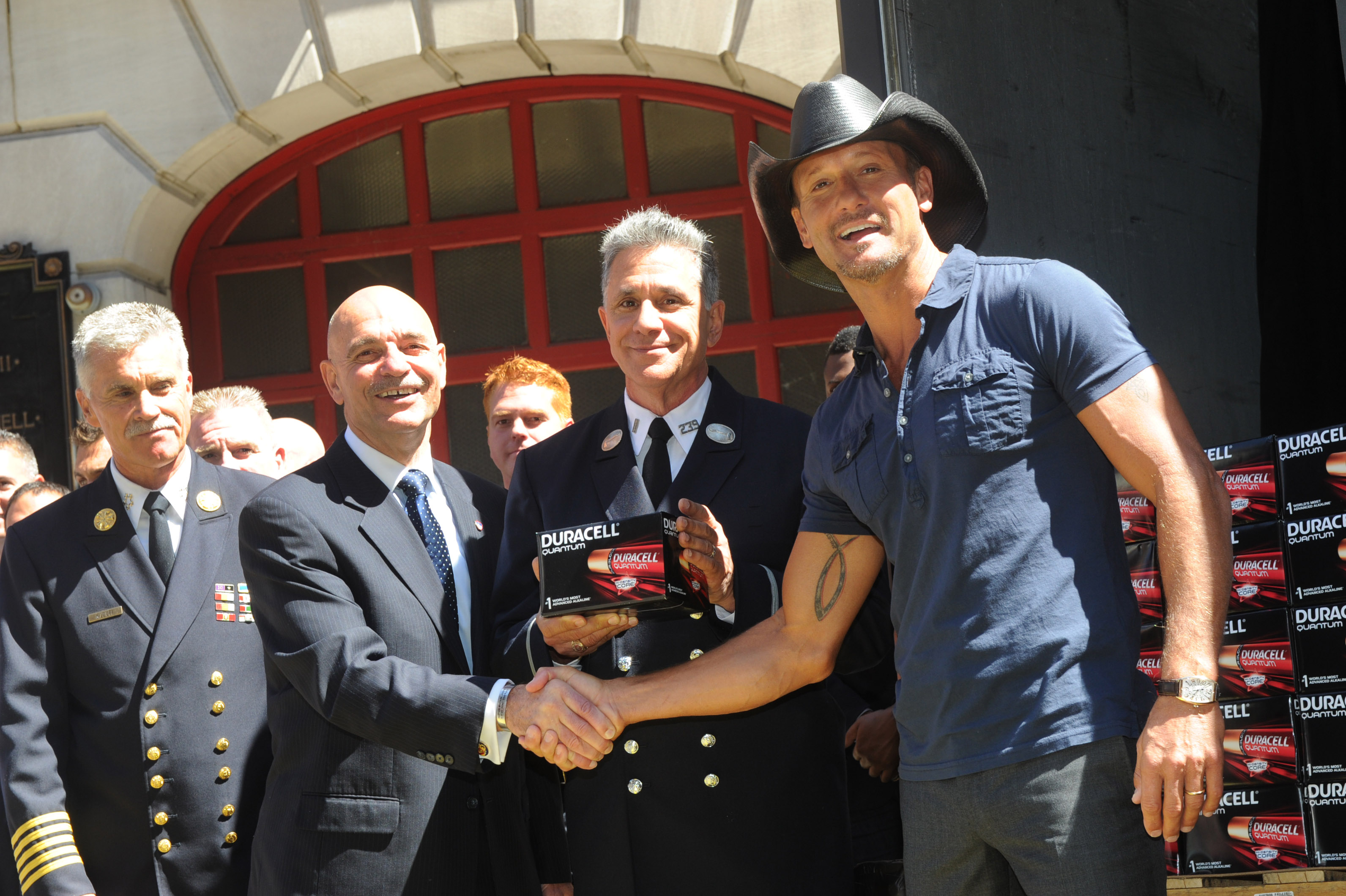 Country music star Tim McGraw hosts the launch event of Duracell's new Quantum battery and announces the donation of one million of these most powerful batteries to first responders, Thursday, Aug. 15, 2013, at an FDNY firehouse in New York. (Diane Bondareff/Invision for Duracell)